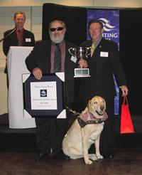 Photo 15.	Paul Borg – 2005 Victorian Sailor of the Year with a Disability with Yachting Victoria President, John Burgess, and Hugh.